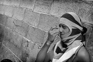 A resident of the Camp uses Onion to subdue the effects of the tear gas, most Palestinians I saw had onion on them for exactly this reason. © Will Hilton