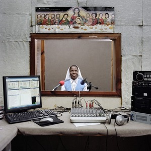 Men Kontre is the radio of the Catholic diocese of Les Cayes. Sister Melianise Gabreus is one of the stars of the radio. Even if there are no official figures, father Elysee, that runs the radio, says that lots of people tune in for Sister's Melianise's program on daily life advice. Les Cayes, Haiti. © Paolo Woods/INSTITUTE