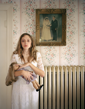 3rd Prize People, Observed Portraits Single © Ilona Szwarc, Poland, Redux Pictures. Kayla, Boston, USA. 19 February 2012, Boston, Massachusetts, USA. American Girl is a popular line of dolls that can be customized to look exactly like their owners. Kayla poses with her lookalike doll in front of a portrait of her ancestors.