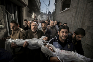 World Press Photo of the Year 2012 © Paul Hansen, Sweden, Dagens Nyheter.  20 November 2012, Gaza City, Palestinian Territories. Two-year-old Suhaib Hijazi and her three-year-old brother Muhammad were killed when their house was destroyed by an Israeli missile strike. Their father, Fouad, was also killed and their mother was put in intensive care. Fouad's brothers carry his children to the mosque.