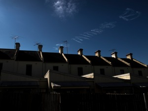 Glebe houses and skywriting.   © Ross Duncan