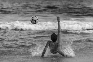Soccer fans playing at Ipanema beach, in Rio de Janeiro. © Luciana Whitaker