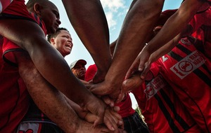 The members of a women's amateur soccer team cheering before their game. © Marlene Bergamo