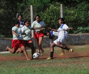 A group of Brazilian-Guarani Indian women play in a soccer game in Paraty, a touristic village on the southern coast near Rio de Janeiro. © Nair Benedicto