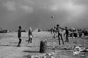 Soccer game at a trash dump in Rio de Janeiro, Brazil. © J.R. Ripper