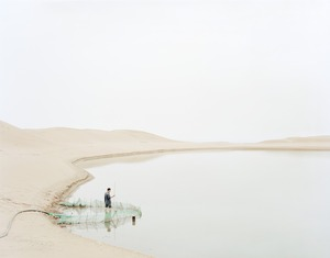 Man Pumping Water in Wasteland, Ningxia Province © Kechun Zhang. Recipient of the Prix découverte