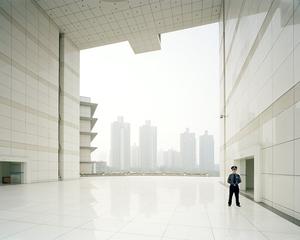 Security Guard, Xingguang Boulevard, Chongqing 2005. © Ferit Kuyas.