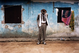 B. Mouzieto in Bacongo. The sapeur Bienvenu Mouzieto poses in front of his house in the Bacongo neighbourhood of Brazzaville, Congo. © Noorderlicht Photography
