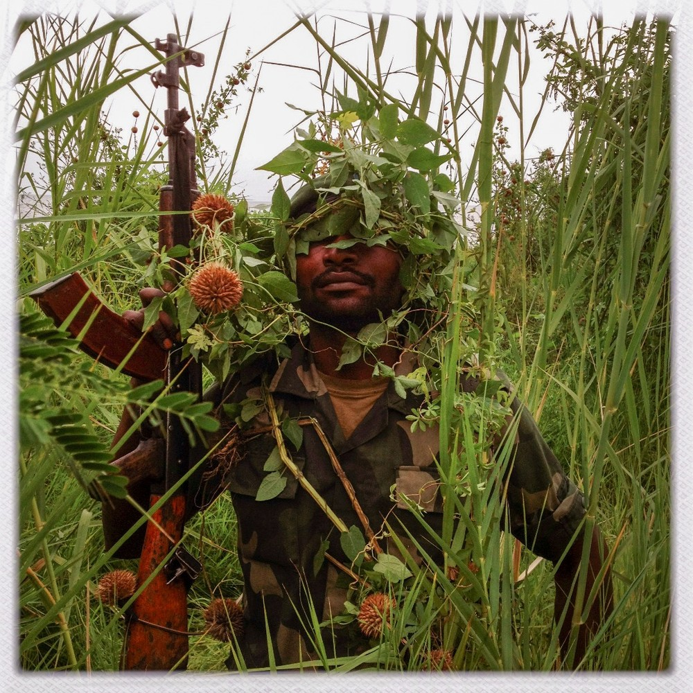 CONGO.  Goma. A FARDC soldier poses for a portrait by Lake Kivu.© Michael Christopher Brown, USA / Magnum Photos, Documentary Photographer. Michael documented the Libyan revolution using a camera phone. He is the subject of the 2012 HBO documentary Witness.  Courtesy blink.la