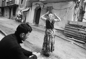A Roma woman walks on the street of Tarlabasi.