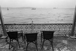 Wicker chairs on a veranda overlooking the Bosphorus.