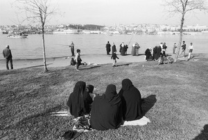 People enjoying a sunny day in a park near Fener Dock, beside the Golden Horn.