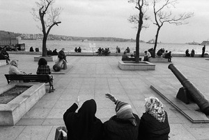 People relax in a park near Kabatas Ferry Dock.