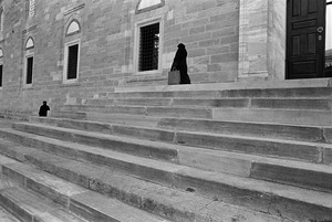 A man and a woman leaving Yeni Cami (New Mosque).