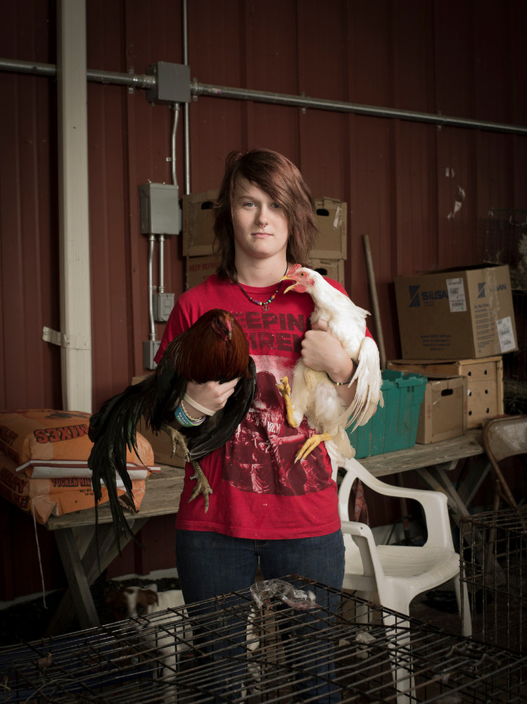 Kenzie Manns is a 15 year old high school student. She works weekends with her step father at the Pendergrass Flea Market in Pendergrass, GA for James Raven in his live poultry business. © Forest McMullin