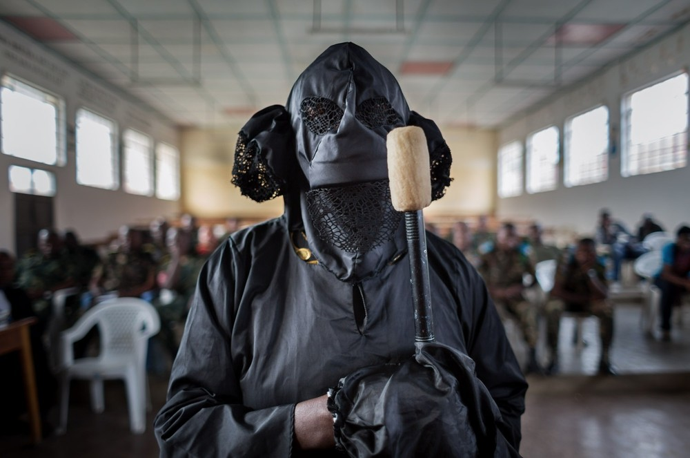 A victim, veiled to protect her identity, testifies. When FARDC soldiers entered her home, her 5 children hid. Her husband was not home. Two soldiers raped her while others carried off goods received from an aid organization: sacks of rice and corn, cans of cooking oil. Her husband returned in the morning. When he learned of the rape, he left and never returned. © Diana Zeyneb Alhindawi
