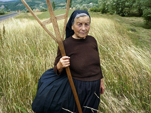 Tiranca, Sirrbi, 2003. Black cloth is the mark of a widow. She will wear something black every day she remains on earth until God decides she should join her husband. © Kathleen Laraia McLaughlin.