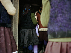 Women in the Back, Sirbi, 2003. In Maramures, Orthodox churches are divided in half. The front half is for men, while the back and outside are for women.  © Kathleen Laraia McLaughlin.
