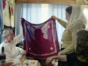 Headscarf, Sirbi, 2002. After years of idolizing all that is new, a sudden shift made old headscarves the it fashion item. And suddenly an older aunts forgotten linens are rediscovered family assets. © Kathleen Laraia McLaughlin.