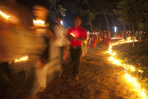 Fatima Rani Thirthok, Boromari, Sherpur, Bangladesh  This procession in honor of Our Lady of Fatima is a new celebration; it is only about five years old, but it already draws almost 10,000 pilgrims, most of them from the Garo indigenous tribe, half of whom were converted to Catholicism in the 19th century. The festivals newness and the recent history of this peoples evangelization do not seem to take away from the fervor with which they venerated, one which to me seemed rooted in a more remote past. © Claudio Cambon