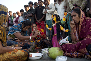 Amidst fishermen unloading their catch, these women perform a puja to Ganga Devi, goddess of the river. I felt out of time, joined to the elements through their devotion. I had the distinct sense that, older than the words to the song was the song itself which solemnly dreamed the goddess into being, a melody that seemed as old as the goddess herself, as the water and the sky that surrounded us.