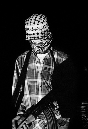 Al-Aqsa Martyr Brigades militants patrol side roads outside Gaza city in eventuality of an Israeli incursion. Gaza, Palesatine 2002 © Paolo Pellegrin