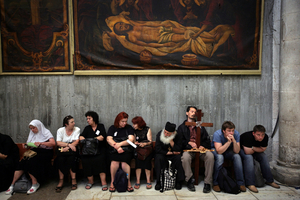 Jerusalem, Apr 08 - Christian pilgrims resting in the Holy Sepulcher church after taking part in Good Friday processions © Natan Dvir