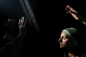 Jerusalem, Apr 06 - Christian pilgrim praying next to Jesus tomb in the Holy Sepulcher church © Natan Dvir