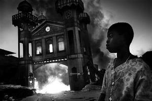 1st Prize General News Single © Riccardo Venturi, Italy, Contrasto. Old Iron Market burns, Port-au-Prince, Haiti, 18 January