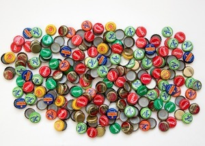 """The bottle caps of all the drinks we bought to get this project done (270 caps in total). From """"Only in Burundi"""" © Anaïs López"""