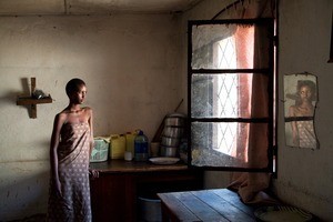 "Ella, one of Koky's four daughters, in her house. From ""Only in Burundi"" © Anaïs López"