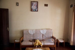 """Koky's youngest daughter Isaora in the living room. From """"Only in Burundi"""" © Anaïs López"""