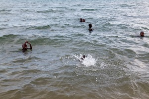 """Children playing in the water on a typical Sunday afternoon at Lake Tanganyika. From """"Only in Burundi"""" © Anaïs López"""