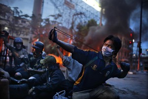 2nd Prize Spot News Stories © Corentin Fohlen, France, Fedephoto.  Anti-government riots, Bangkok, Thailand, May