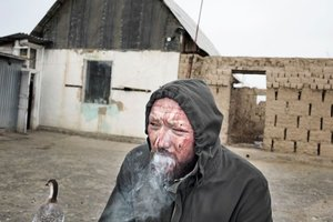 Kostya smoking after the ritual. From the series Apashka by © Pavel Prokopchik