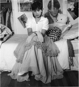 Julia, preteen with fily skirt and gloes, silver print, ca. 1987, © Joanne Leonard