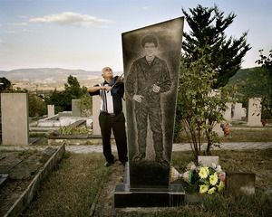 UNRECOGNIZED REPUBLIC OF NAGORNO-KARABAKH / Stepanakert / 10.09.2011. In the war cemetery of Stepanakert Boris Babajan (born 1948) plays the violin near a burial site of a soldier killed in the Karabakh war. During the war Boris Babajan was in the artillery but did not take part in active fights. However, he had the idea to play the violin during the funeral service for his killed colleagues.