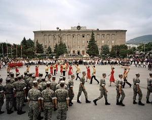 UNRECOGNIZED REPUBLIC OF NAGORNO-KARABAKH / Stepanakert / 1.9.2011. On Independence Square in front of the Presidential Palace and under the eyes of the presidents of both Armenia and Nagorno-Karabakh, Serzh Sarkisian and Bako Sahakyan, soldiers of the Karabakhi army, as well as male and female dancers are dancing a folk dance. It is one day prior to the important National Holiday.
