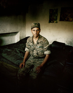UNRECOGNIZED REPUBLIC OF NAGORNO-KARABAKH / Ceasefire line between Nagorno-Karabakh and Azerbaijan / 5.9.2011. Aram, 18 years old, on active service in the Karabakhi army since half a year ago, is shown here in his sleeping place which is directly along the ceasefire line.