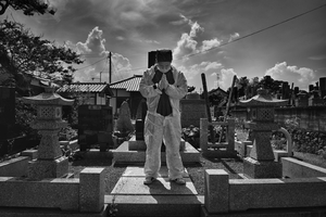 "Mister Matsumoto, Yakuza member and TEPCO contractor is praying on his family grave, from the series Fukushima ""No Go"" Zone, © Pierpaolo Mittica."