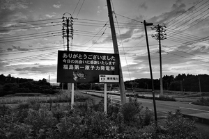 "The roadsign put up by TEPCO at the exit of Fukushima Daiichi nuclear plant reads: ""Thank you for your visit, it was great to meet you, hope to see you soon. -TOKYO DENRYOKU (TEPCO)"", from the series Fukushima ""No Go"" Zone, © Pierpaolo Mittica."
