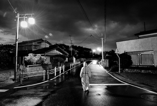 "Animal activist in search of abandoned animals in Odaka city, from the series Fukushima ""No Go"" Zone, © Pierpaolo Mittica."
