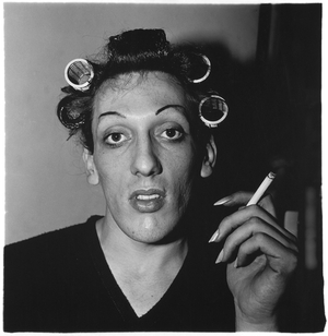 A young man in curlers at home on West 20th Street, N.Y.C., 1966, © The Estate of Diane Arbus LLC, Courtesy Jeu de Paume