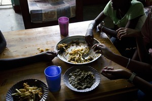 """The daughters of Koky having a typical Burundian dinner, French fries with rice and vegetables. From """"Only in Burundi"""" © Anaïs López"""