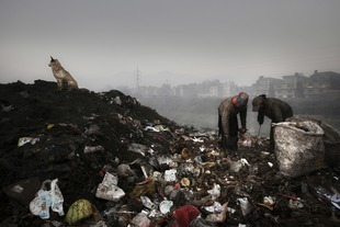Women picking garbage near the bank of the Bagmati river. Around 100 tons of waste are generated daily, close to a quarter of the total remains uncollected and is left to decay on the streets and in rivers. © Alessio Mamo