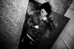 Drunken woman is sleeping in the corridor of the Narcological Clinic.