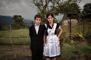 Kids in school uniforms are going to school. New Athos, Abkhazia.© Olga Ingurazova