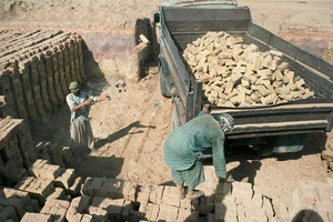 © Iva Zimova. Labourers load a truck with bricks at at a factory near Mazar-e-Sharif.