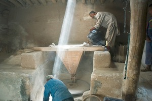 © Iva Zimova. Two men work in a flour mill.