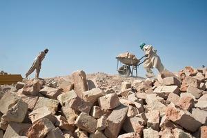 © Iva Zimova. A labourer pushes a wheelbarrow full of bricks at a factory outside Mazar-e Sharif.